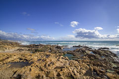 Seascape with rocks. And deep blue sky during hot summer day Stock Images