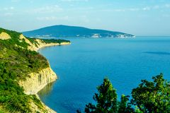 Seascape with rocks, blue sky and Caucasus mountains on the black sea royalty free stock photos