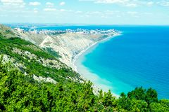 Seascape with rocks, blue sky and Caucasus mountains on the black sea stock images