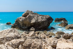 Seascape with rocks in blue waters of Megali Petra Beach, Lefkada, Greece Royalty Free Stock Photo
