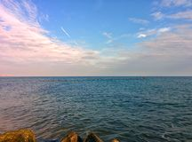 Seascape with rocks and clouds. Sea, clouds and blue sky Royalty Free Stock Image
