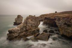 Seascape with rocks. And crashing waves Stock Photo