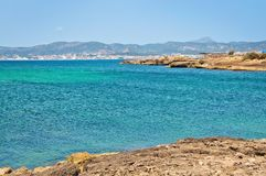 Seascape with rocks and Palma skyline. On a sunny summer day in Mallorca, Spain Royalty Free Stock Photography
