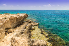 Seascape with rocks on the shore of the Mediterranean Sea. Stock Photo