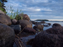 Seascape with rocks and sky with clouds Stock Image