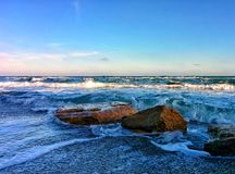 Seascape with rocks and splashes on sea shore Royalty Free Stock Photo