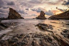 Seascape with rocks. Sunrise on the beach Royalty Free Stock Photos
