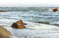 Seascape of rocks in a turbulent water Stock Images