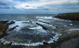 Seascape rocks. Wide angle seascape with clouds on the sky Royalty Free Stock Images