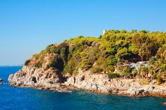 Seascape with rocky beach in Lloret de Mar, Costa brava, Spain. Rocks on sea coastline. Sunny day in bay. Sea nature landscape in mediterranean. Beautiful view stock photos