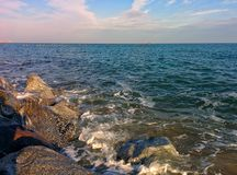 Seascape from rocky coast. Rocks, sea and cloudy blue sky Royalty Free Stock Photography