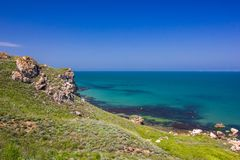 Seascape and rocky shore on a clear day royalty free stock images