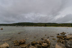 Seascape of rocky shoreline on a cloudy day Stock Photo