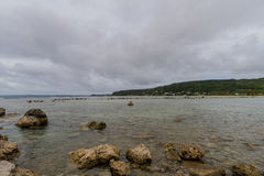 Seascape of rocky shoreline on a cloudy day Royalty Free Stock Images
