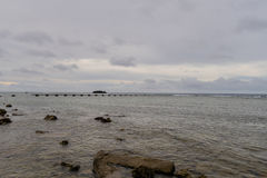 Seascape of rocky shoreline on a cloudy day Stock Images