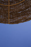 Seascape. Roof of twigs against the blue sky Royalty Free Stock Image