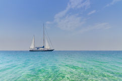 Seascape with sailboat Stock Images