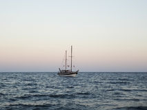 Seascape and a sailing ship Stock Photography