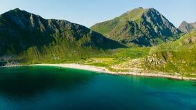 Seascape with sandy beach Lofoten Norway. Coast of Vestvagoy island, Uttakleiv location. Seascape with scenic shoreline high mountains and sandy beach. Lofoten stock photo