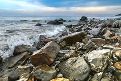 Seascape, scenic large stones against the sea and sky Royalty Free Stock Photo