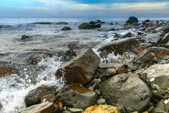 Seascape, scenic large stones against the sea and sky Stock Photography