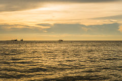 Seascape with scenic sunset and boats Stock Photos