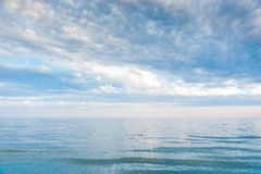 Seascape with sea horizon and blue sky. Background. Painterly seascape scene with relaxing sunset colours stock image