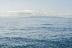 Seascape with sea horizon and almost clear deep blue sky. Athens, Greece royalty free stock images