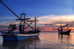 Seascape. Sea sunrise and Blue sky with fishing boat Stock Image