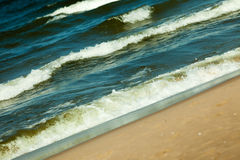 Seascape. Sea waves on shore of sandy beach. Stock Photos