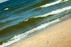 Seascape. Sea waves on shore of sandy beach. Royalty Free Stock Photography