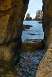 Seascape through slit in rock. Stock Photography