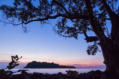 Seascape with small island at dusk twilight Royalty Free Stock Photos