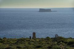 Seascape with a small island and the Monument in memory of Sir Walter Norris Congreve in Malta stock photo