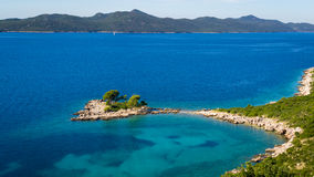 Seascape with small island near Dubrovnik. Beautifull seascape with small island near Dubrovnik with hills in the background Stock Photos