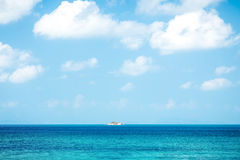 Seascape with small island in the tropical sea Royalty Free Stock Photo