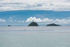 Seascape with small islands and cloudy sky royalty free stock photography