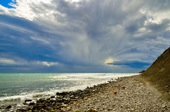 Seascape with storm clouds on a scenic sky on the shore Black sea, Crimea, Sudak royalty free stock photo
