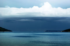 Seascape with stormy sky. Stormy skies over exit of the Boka Bay (Montenegro stock photo