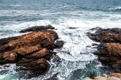Seascape with stormy waves and rocks Stock Photo