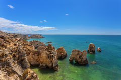 Seascape in the summer on beaches of Albufeira. Portugal. Seascape in the summer on the beaches of Albufeira. Portugal Royalty Free Stock Image