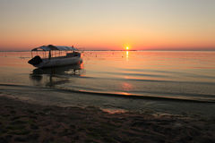Seascape summer sunset with boat Stock Image