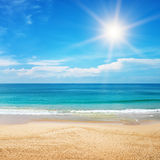 Seascape and sun on blue sky background Stock Photos