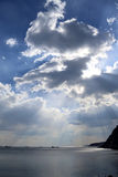 Seascape with Sun rays falling throw the clouds Stock Image