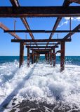 Under the abandoned pier. royalty free stock photography