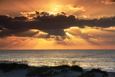 Sunrays Clouds Ocean Hatteras NC Sunrise. East coast landscape of sun rising over the Altantic Ocean in Frisco North Carolina shining rays through the openings Royalty Free Stock Photography