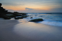 Seascape sunrise flowing waves Stock Images