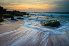 Seascape sunrise flowing waves Stock Image