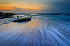 Seascape sunrise flowing waves Royalty Free Stock Images