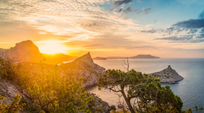 Seascape at sunrise in the mountains. Seascape in the mountains early in the morning at sunrise summer in Crimea Royalty Free Stock Photography